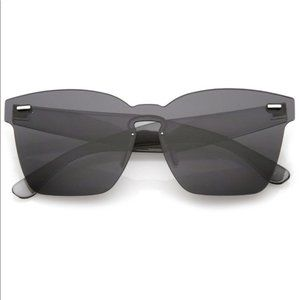 """Sheer Nerve"" Black Rimless Mono Block Sunglasses"